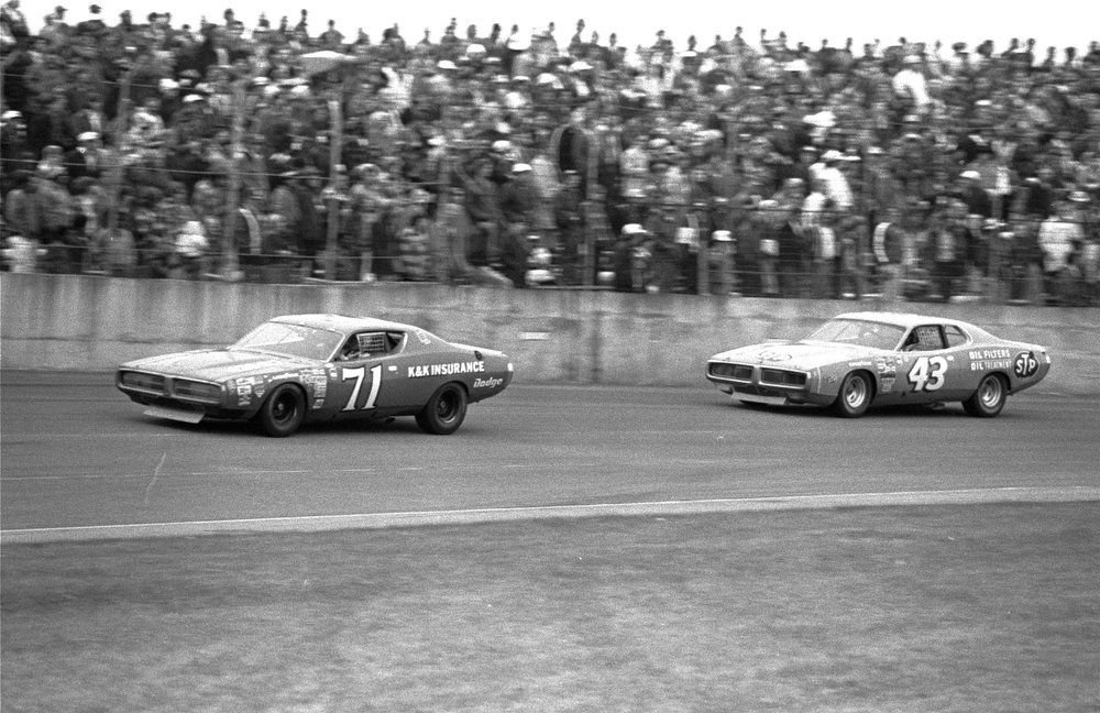 Description of . Richard Petty in car 43 chases Buddy Baker in car 71 during the Daytona 500 race February 19, 1973.  Moments before the race ended, Baker withdrew from the race because of engine trouble and Petty went on to an unprecedented fourth victory in the 500.  (AP Photo)