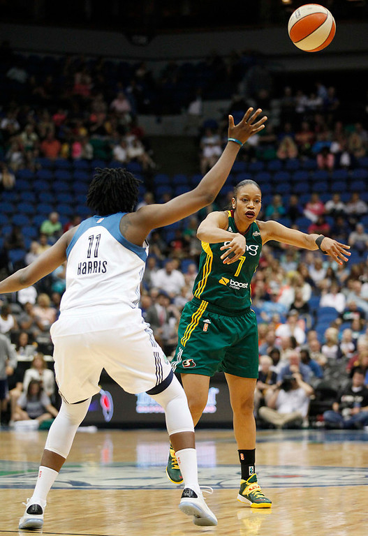 . Seattle Storm forward Tina Thompson (7) passes the ball over Minnesota Lynx forward Amber Harris (11) in the second half of a WNBA basketball game, Sunday, Aug. 4, 2013, in Minneapolis. The Lynx won 90-72. (AP Photo/Stacy Bengs)