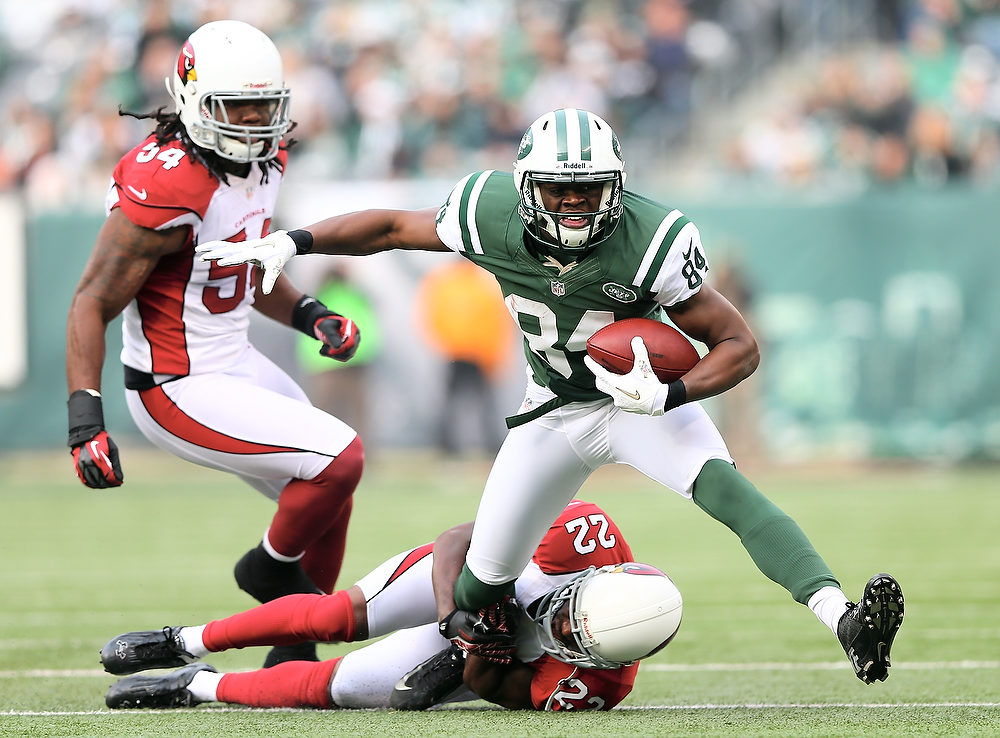 . Stephen Hill #84 of the New York Jets tries to get a few extra yards as William Gay #22 and Quentin Groves #54 of the Arizona Cardinals defend on December 2, 2012 at MetLife Stadium in East Rutherford, New Jersey.  (Photo by Elsa/Getty Images)