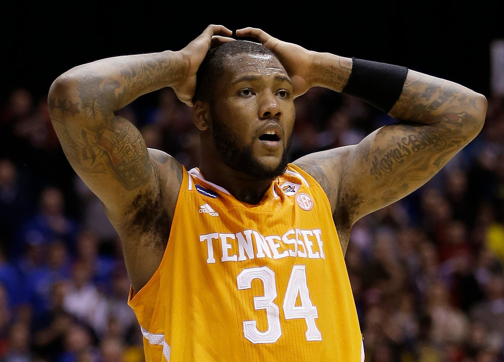 . Tennessee\'s Jeronne Maymon reacts during the second half of an NCAA Midwest Regional semifinal college basketball tournament game against the Michigan Friday, March 28, 2014, in Indianapolis. (AP Photo/David J. Phillip)