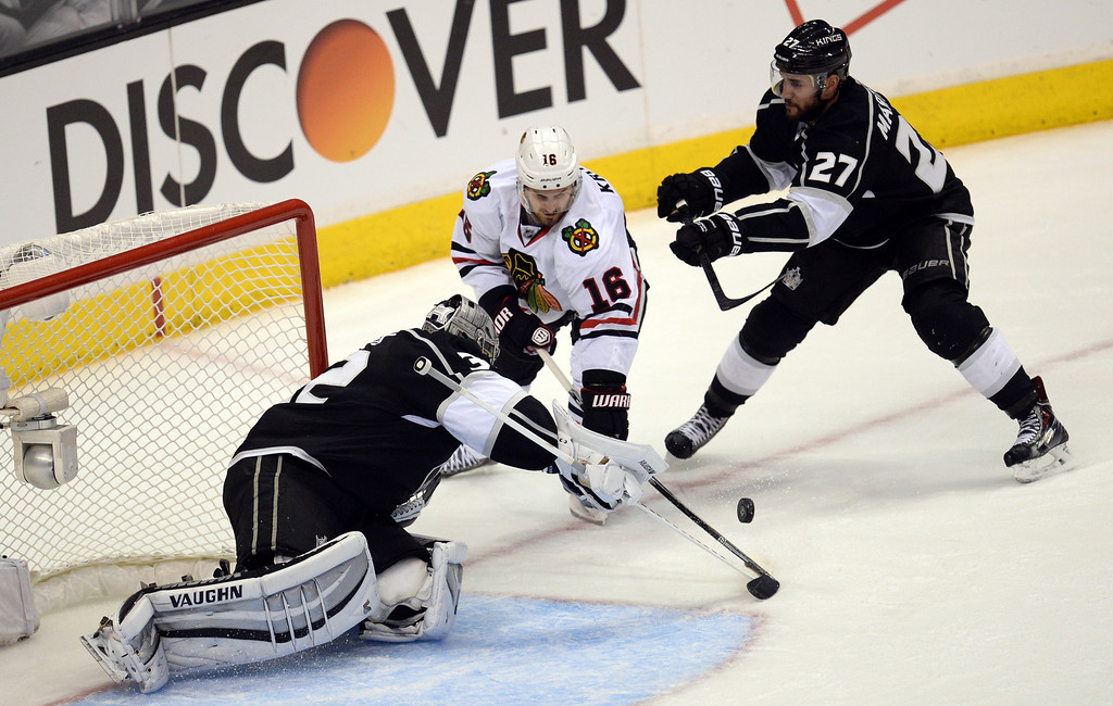 . Kings� goalie Jonathan Quick #32 stops a shot by the Blackhawks� Marcus Kruger #16 as Alec Martinez #27 moves in during Game 3 of the Western Conference finals at the Staples Center on Saturday, May 24, 2014. (Photo by Hans Gutknecht/Los Angeles Daily News)
