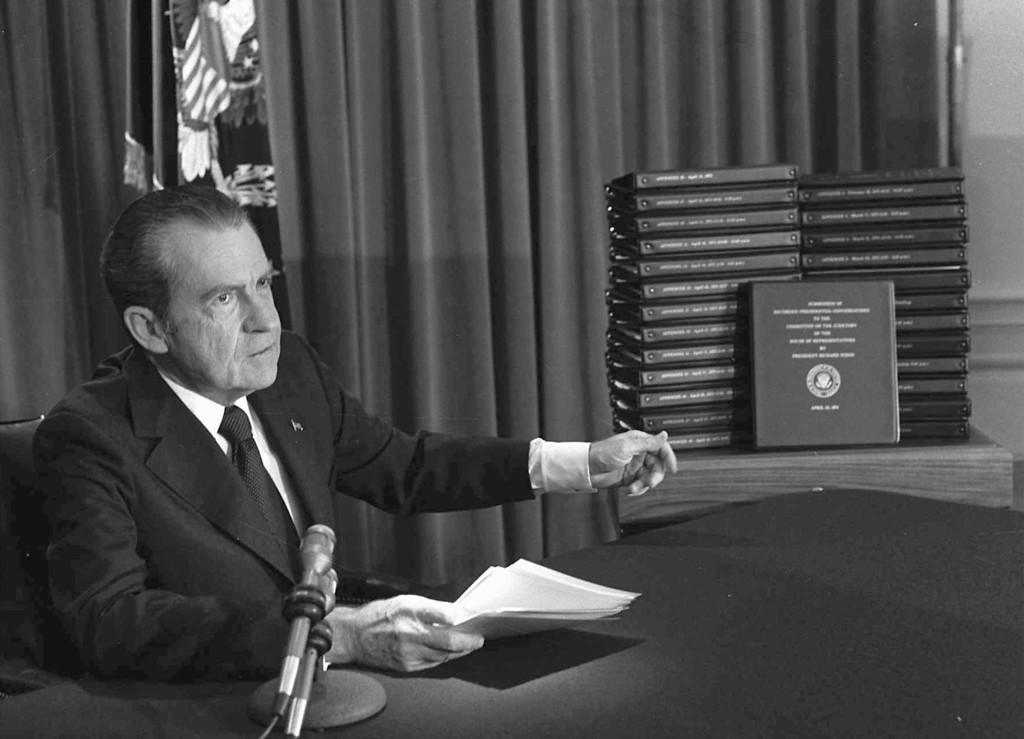 . President Richard M. Nixon is shown pointing to the transcripts of the White House tapes in this April 29, 1974, file photo, after he announced during a nationally-televised speech that he would turn over the transcripts to House impeachment invesigators. 30 years ago, on Aug. 9, 1974, US-President Richard M. Nixon resigned due to the Watergate affair. (AP Photo)
