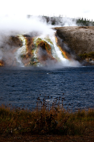 steam and hot water from the Midway geyser basin flowing into the river
