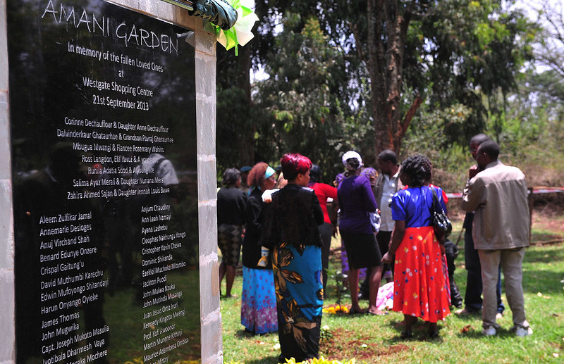 . Relatives of victims of the Westgate Mall attack gather during a ceremony marking the first anniversary of the attack, outside the Westgate mall in Nairobi on September 21, 2014. At least 67 people were killed and scores wounded when a small group of Al-Qaeda affiliated fighters stormed the Westgate mall on September 21 2013. CARL DE SOUZA/AFP/Getty Images