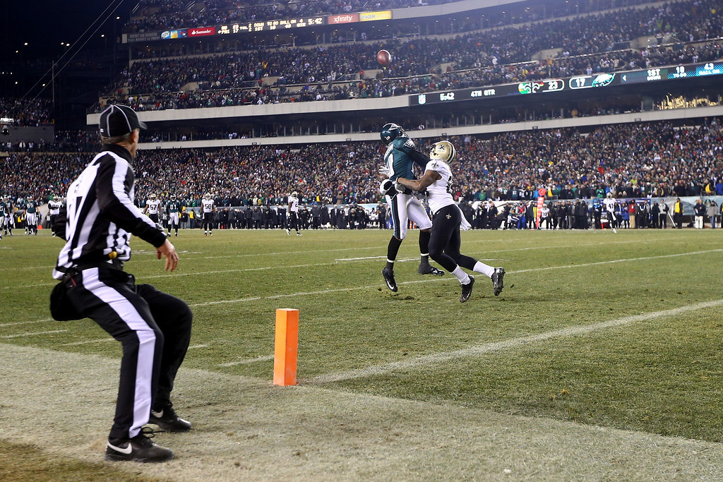 . PHILADELPHIA, PA - JANUARY 04:    Corey White #24 of the New Orleans Saints covers DeSean Jackson #10 of the Philadelphia Eagles causing a 40 yard Defensive Pass Interference call in the fourth quarter during their NFC Wild Card Playoff game at Lincoln Financial Field on January 4, 2014 in Philadelphia, Pennsylvania.  (Photo by Elsa/Getty Images)