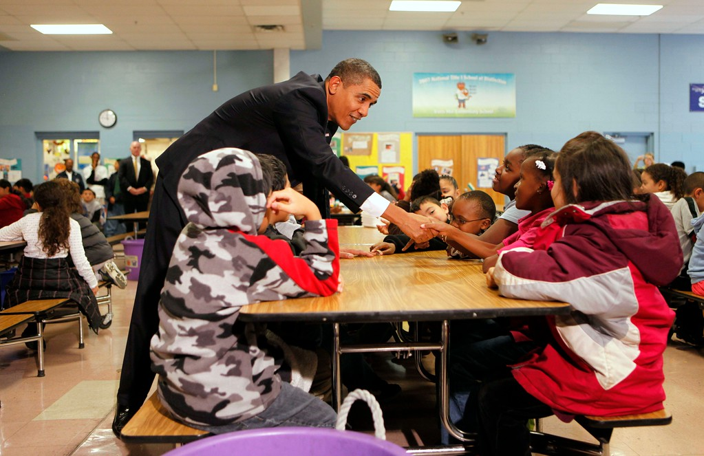 . President Barack Obama talks to third and fourth grade students at Viers Mill Elementary School in Silver Spring, Md., Monday, Oct. 19, 2009. (AP Photo/Gerald Herbert)