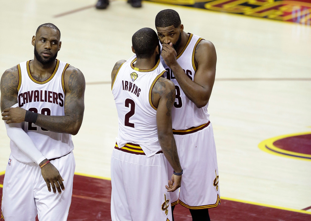 . Cleveland Cavaliers guard Kyrie Irving (2) and Tristan Thompson (13) talk during play against the Golden State Warriors in the first half of Game 4 of basketball\'s NBA Finals in Cleveland, Friday, June 9, 2017. (AP Photo/Tony Dejak)
