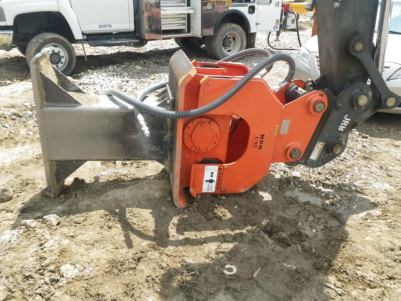 NPK C6C compactor with foot extension on Deere excavator-backfilling deep trench(11).JPG