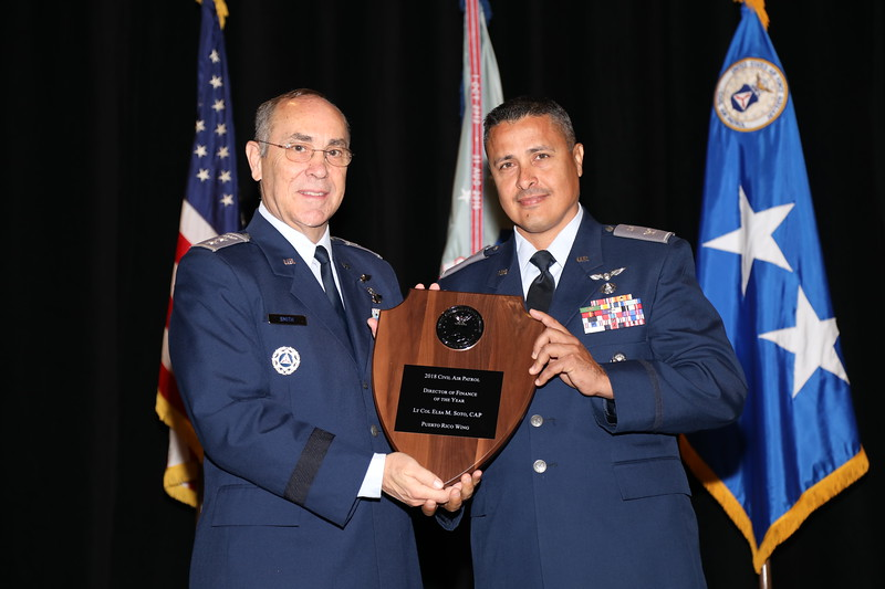 The Director of Finance of the Year Award was established to recognize the director of finance who has contributed the most to CAP's financial management program during the year.  The recipient of the Director of Finance of the Year Award is Lt Col Elsa Soto.  Accepting the award on her behalf is PRWG CC Col Carlos Fernandez.  Photo by Susan Schneider, CAPNHQ