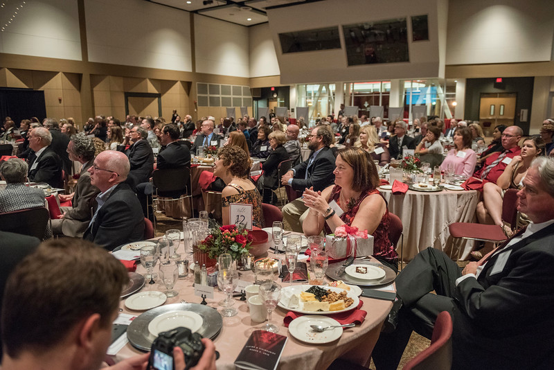 Lori McAdams (COMM, '83) (center) and other Distinguished Alumni are recognized during an evening dinner on Friday, March 9, 2018 in Chico, Calif.  (Jason Halley/University Photographer/CSU Chico)