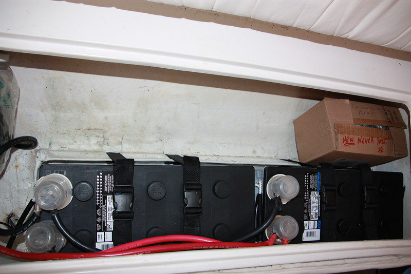 TUIT batteries under port salon seat.JPG