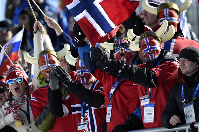 . Norway\'s fans wave with national flag during the Women\'s Cross-Country Skiing 7,5km + 7,5km Skiathlon at the Laura Cross-Country Ski and Biathlon Center during the Sochi Winter Olympics on February 8, 2014 in Rosa Khutor. (ODD ANDERSEN/AFP/Getty Images)