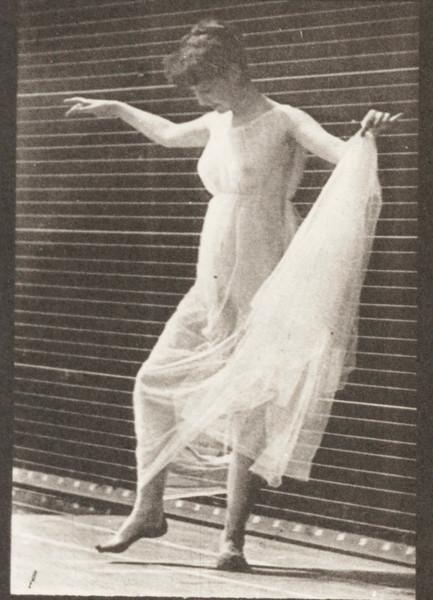 Woman in dress dancing
