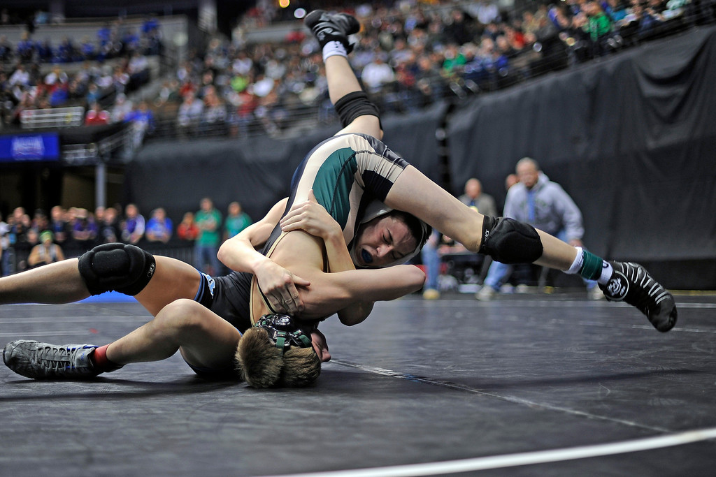 . Mountain Range\'s Trent Thomas, top, and Bear Creek\'s Jaysen Yakobson, bottom, in 106 lb class 5A State Wrestling action Thursday February 16, 2012 at the Pepsi Center in Denver, CO. Hyoung Chang/The Denver Post