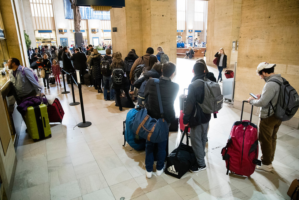 . Travelers stand in line to board a train at the 30th Street Station in Philadelphia, Tuesday, Nov. 22, 2016. Almost 49 million people are expected to travel 50 miles or more for the holiday, the most since 2007, according to AAA. Most of them will drive, helped by relatively low gas prices and an improving economy.  (AP Photo/Matt Rourke)