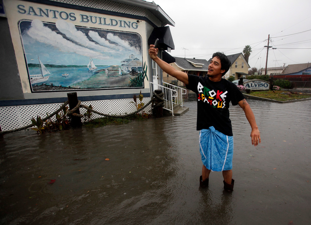 . Johnny Ochoa takes a selfie while standing in a flood Taylor Street near his house in Alviso, Calif., Thursday, Dec. 11, 2014. (Karl Mondon/Bay Area News Group)