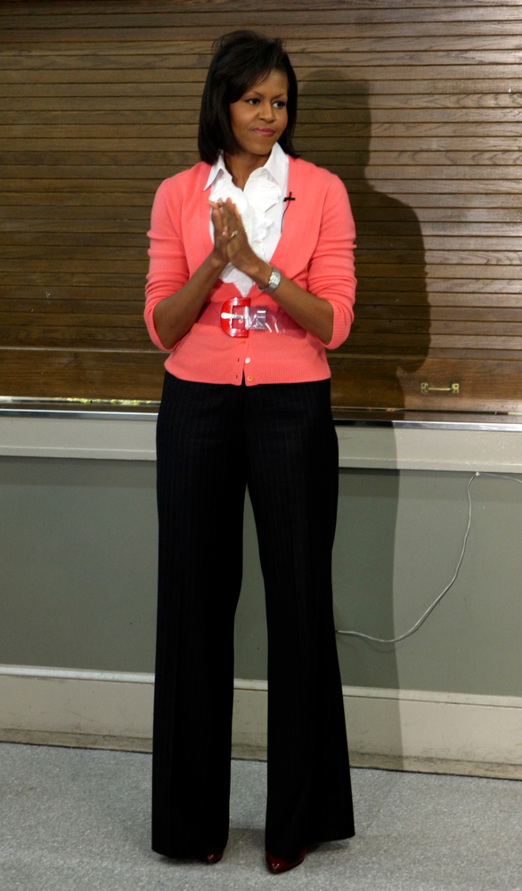 Description of . This March 5, 2009 file photo shows first lady Michelle Obama waits to be introduced after handing out meals during her visit to Miriam's Kitchen in Washington. (AP Photo/Pablo Martinez Monsivais,File)