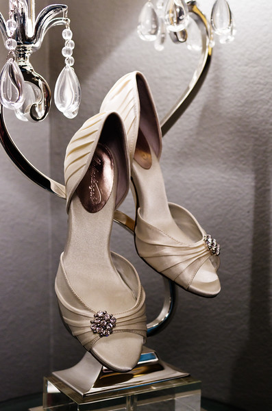 Brides shoes and candelabra