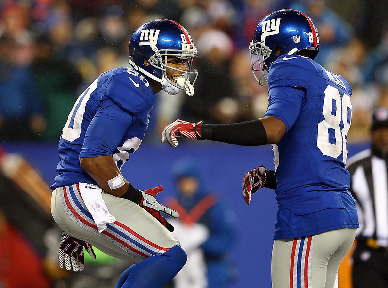 . Victor Cruz #80 of the New York Giants celebrates his touchdown with teammate  Hakeem Nicks #88 on December 9, 2012 at MetLife Stadium in East Rutherford, New Jersey.  (Photo by Elsa/Getty Images)
