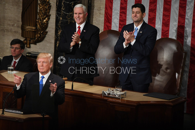 President Donald Trump gives his first State of The Union Address as Vice President Mike Pence and Speaker of The House Paul Ryan applaud.