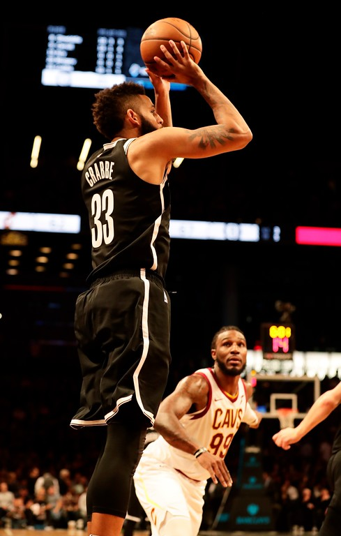 . Brooklyn Nets\' Allen Crabbe (33) shoots a three point basket over Cleveland Cavaliers\' Jae Crowder (99) during the second half of an NBA basketball game Wednesday, Oct. 25, 2017, in New York. The Nets won 112-107. (AP Photo/Frank Franklin II)