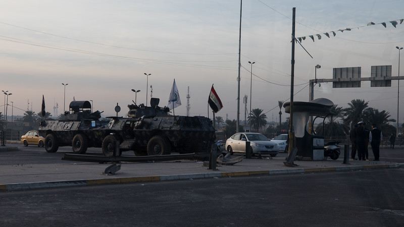 Armoured personnel carriers blocking the road in Baghdad. There are frequent government protests on Friday morning in the city after prayers so the Police close some of the roads to traffic to allow the people to march unimpeded.