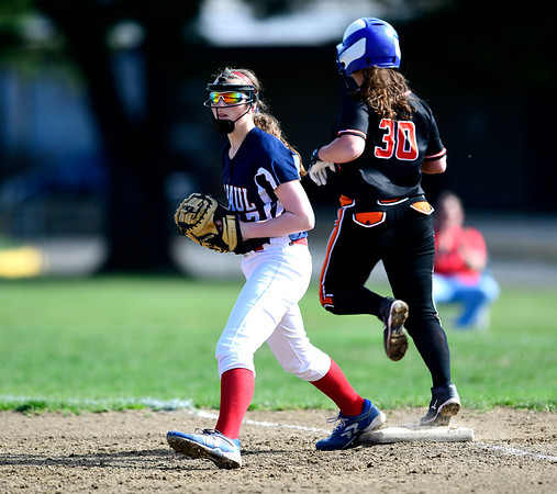 4/17/2019 Mike Orazzi | Staff St. Paul softball's Gillian Smith (17) and Watertown's Julia Spagnoletti (30) during Wednesday's game in Bristol.