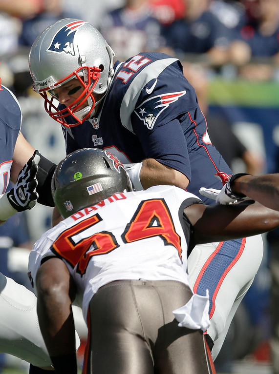 . Tampa Bay Buccaneers linebacker Lavonte David (54) sacks New England Patriots quarterback Tom Brady (12) in the first half of an NFL football game Sunday, Sept. 22, 2013, in Foxborough, Mass. (AP Photo/Stephan Savoia)