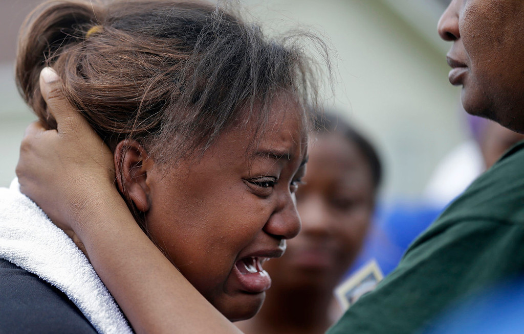 . Lisa North, the mother of missing 6-year-old Ahlittia North, cries in the arms of her mother, Rene\' Johnson, right, after she says Jefferson Parish authorities have found the body of her daughter in a Harvey trash bin, in Harvey, La., Tuesday, July 16, 2013. Ahlittia disappeared from her apartment late Friday night or early Saturday morning. North\'s husband Albert Hill said they were told the body was found in a trash bin not far from their apartment. (AP Photo/Gerald Herbert)