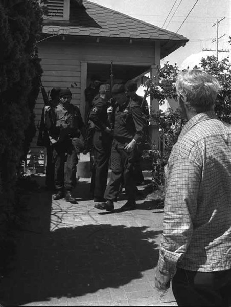 . This is a May 19, 1974 photo of police officers leaving a home in Los Angeles after it was raided on suspecion of being a Symbionese Liberation Army hideout. (AP Photo)