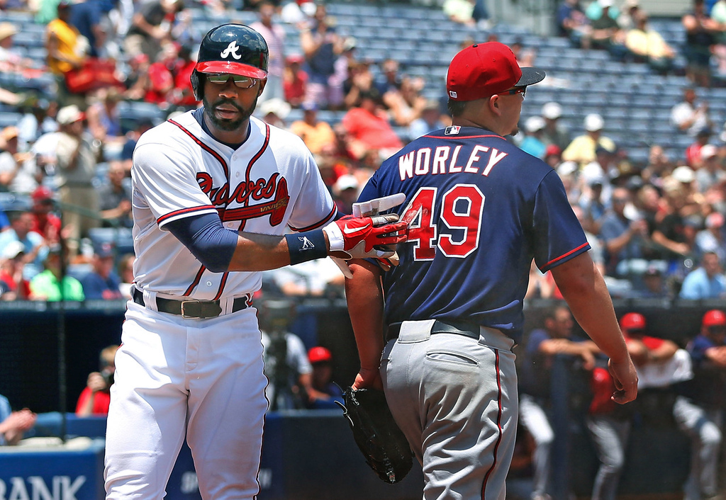 . Atlanta\'s Jason Heyward, steps past Twins starter Vance Worley after scoring on a single by Chris Johnson in the third inning.  (Photo by Kevin C. Cox/Getty Images)