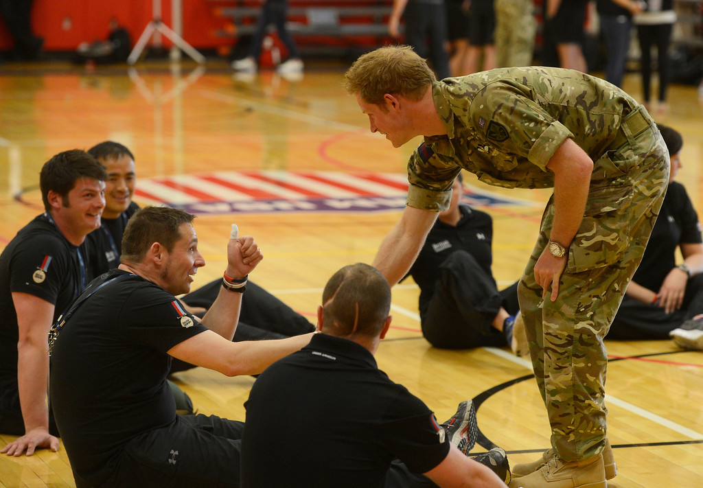 . COLORADO SPRINGS, CO - MAY 11: Britain\'s Prince Harry, greets British Armed Forces athlete Grant Harvey, who gave the Prince an involuntary thumbs-up at the United States Olympic Training Center for the 2013 Warrior Games Saturday morning, May 11th, 2013. Harvey, a former military police Sgt. is suffering with multiple sclerosis, but is competing in several Warrior Games events including volleyball and shooting. Brentley says that that he has uncontrollable movements in his hands sometimes, but the thumbsup was �good timing.� (Photo By Andy Cross/The Denver Post)