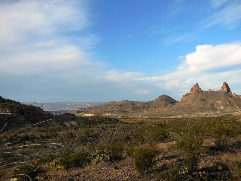 Right to left: Mule's Ears, point 3528 (rounded peak), the lower sections of Smoky Creek drainage, and the Sierra Ponce (?) in Chihuahua, Mexico, from Smoky Spring.