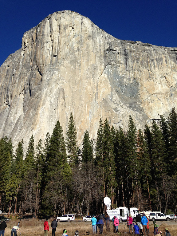 . Media members watch as two climbers vying to become the first in the world to use only their hands and feet to scale a sheer slab of granite make their way to the summit of El Capitan Wednesday, Jan. 14, 2015, in Yosemite National Park, Calif. The pair are closing in on the top of the 3,000-foot (900-meter) peak and if all goes as planned, 30-year-old Kevin Jorgeson of California and 36-year-old Tommy Caldwell of Colorado, should complete their climb early Wednesday afternoon. (AP Photo/Ben Margot)