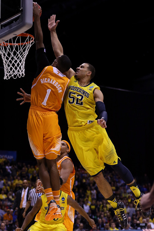 . Josh Richardson #1 of the Tennessee Volunteers shoots the ball against Jordan Morgan #52 of the Michigan Wolverines  during the regional semifinal of the 2014 NCAA Men\'s Basketball Tournament at Lucas Oil Stadium on March 28, 2014 in Indianapolis, Indiana.  (Photo by Jonathan Daniel/Getty Images)