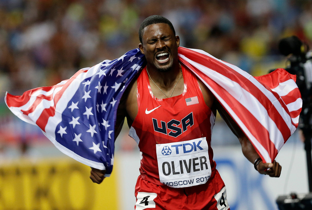 . USA\'s David Oliver celebrates after winning the men\'s 110-meter hurdles at the World Athletics Championships in the Luzhniki stadium in Moscow, Russia, Monday, Aug. 12, 2013. (AP Photo/Anja Niedringhaus)