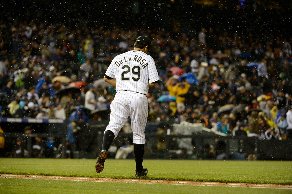 . DENVER, CO. - MAY 07: Jorge De La Rosa (29) of the Colorado Rockies heads to the mound as the rain begins to fall in the fourth inning May 7, 2013 at Coors Field. (Photo By John Leyba/The Denver Post)