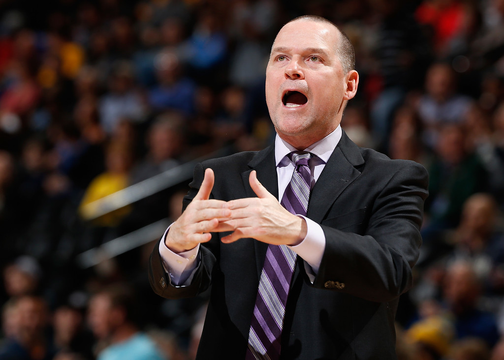 . DENVER, CO - NOVEMBER 03:  Head coach Michael Malone of the Sacramento Kings calls a time out against the Denver Nuggets at Pepsi Center on November 3, 2014 in Denver, Colorado. NOTE TO USER: User expressly acknowledges and agrees that, by downloading and or using this photograph, User is consenting to the terms and conditions of the Getty Images License Agreement.  (Photo by Doug Pensinger/Getty Images)
