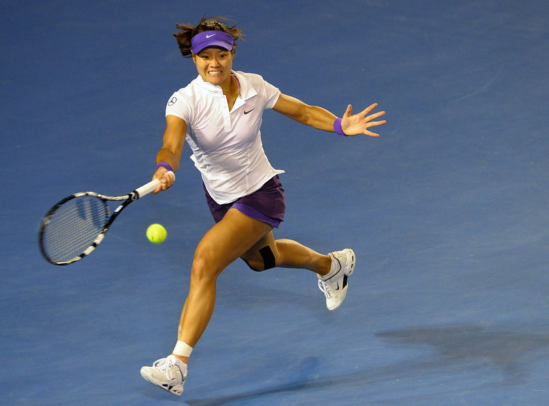 . China\'s Li Na hits a return against Belarus\'s Victoria Azarenka during the women\'s singles final on day 13 of the Australian Open tennis tournament in Melbourne on January 26, 2013. WILLIAM WEST/AFP/Getty Images