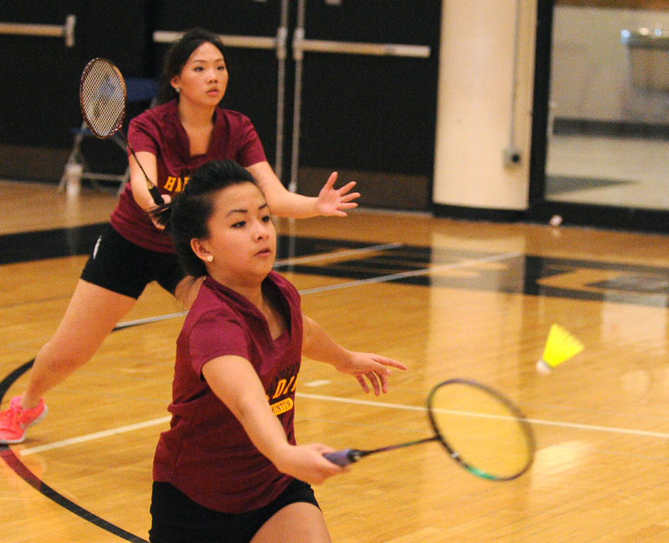. Harding juniors Yer Lor, foreground, and Anna Vue in doubles play against Johnson\'s Coua Lee and Jenny Vang. (Pioneer Press: John Autey)