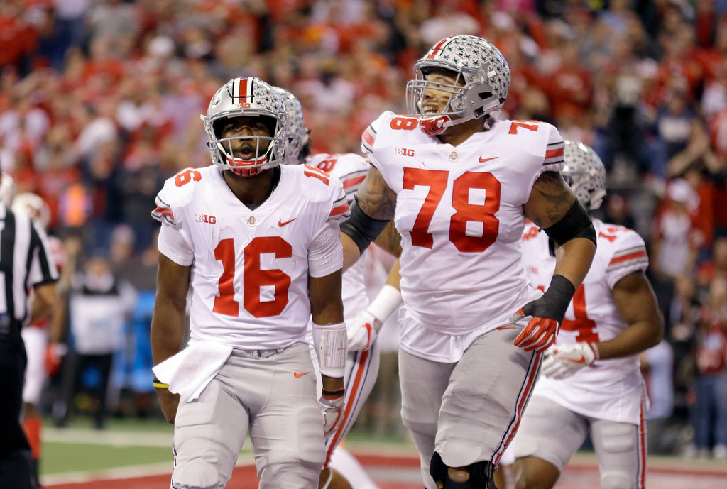 . Ohio State quarterback J.T. Barrett, left, and offensive lineman Demetrius Knox celebrate during the first half of the Big Ten championship NCAA college football game against Wisconsin, Saturday, Dec. 2, 2017, in Indianapolis. (AP Photo/Michael Conroy)