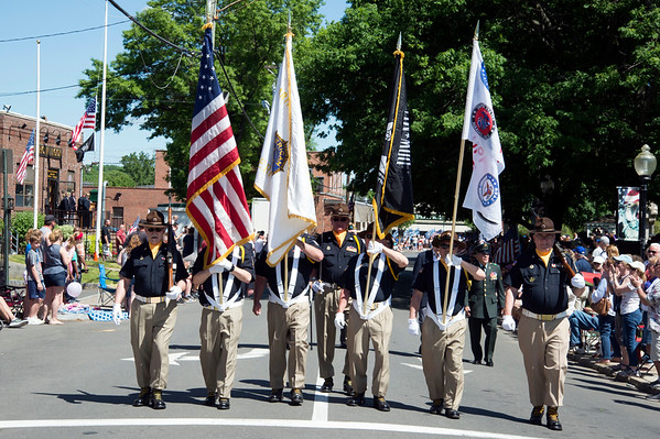 05/27/19 Wesley Bunnell | Staff The American Legion Post 72 Honor Guard marches down Main St during Monday's Memorial Day Parade.
