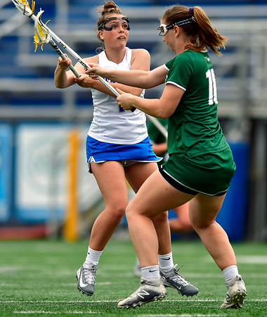 4/20/2019 Mike Orazzi | Staff CCSU Women's Lacrosse's Lily Sheridan (1) and Wagner's Maggie Jent (10) in New Britain on Saturday.