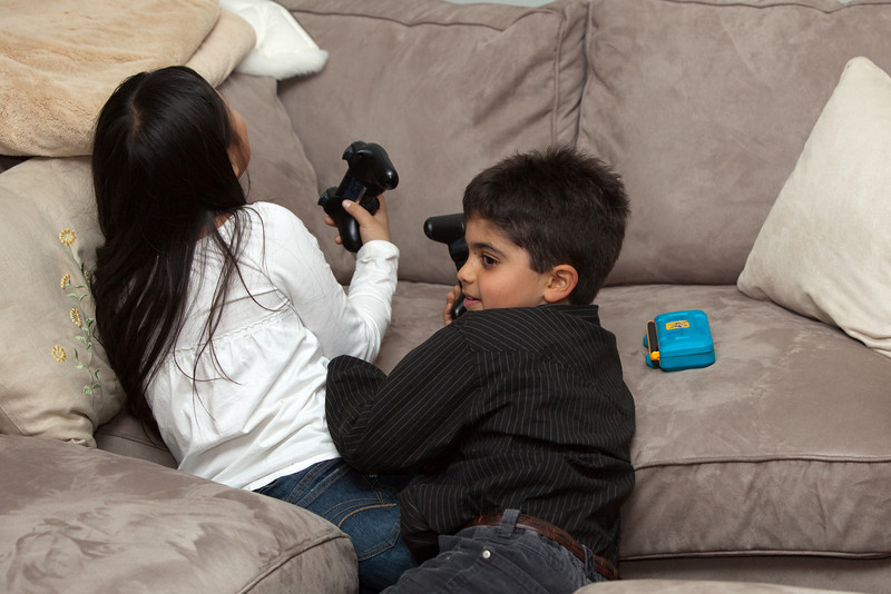 Sophia and Andre fight over who gets to have controller 1 for another round of LittleBigPlanet