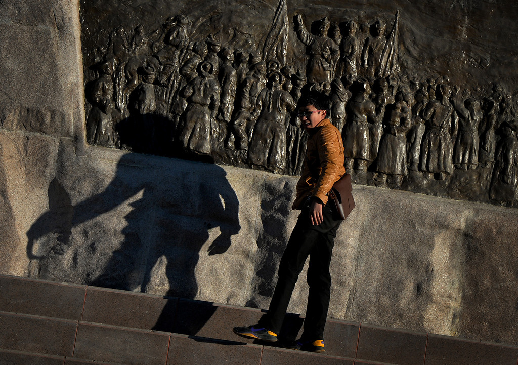 . This photo taken on May 31,2013 shows a Mongolian boy beneath a statue of Genghis Khan on Sukhbaatar Square in Ulan Bator, Mongolia. The country is in the middle of a resources boom with the huge copper and gold Oyu Tolgoi soon to open and which will provide vast revenues for the government that can be spent on infrastructure and education if corruption can be kept in check. MARK RALSTON/AFP/Getty Images