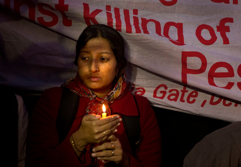 . An Indian woman participates in a candlelight vigil in memory of the victims of Tuesday\'s Taliban attack in Peshawar, in New Delhi, India, Wednesday, Dec. 17, 2014. Pakistanis mourned as mass funerals got underway Wednesday for more than 100, most of them children, killed the day before in a massacre by the Taliban at a military-run school in the country\'s troubled northwest. (AP Photo/Manish Swarup)
