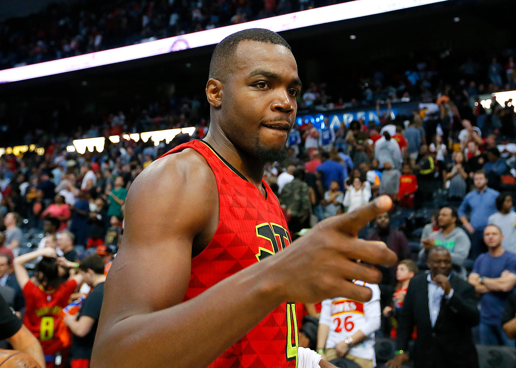 . Atlanta Hawks forward Paul Millsap (4) celebrates the overtime victory as he leaves the court after an NBA basketball game against the Cleveland Cavaliers, Sunday, April 9, 2017, in Atlanta. The Hawks won in overtime 126-125. (AP Photo/Todd Kirkland)