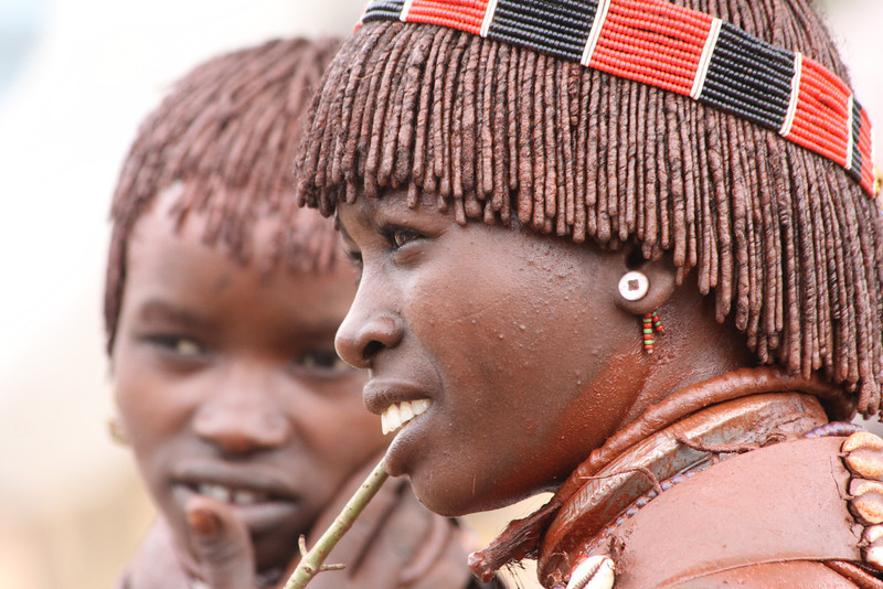 Hamer woman with stick to clean teeth