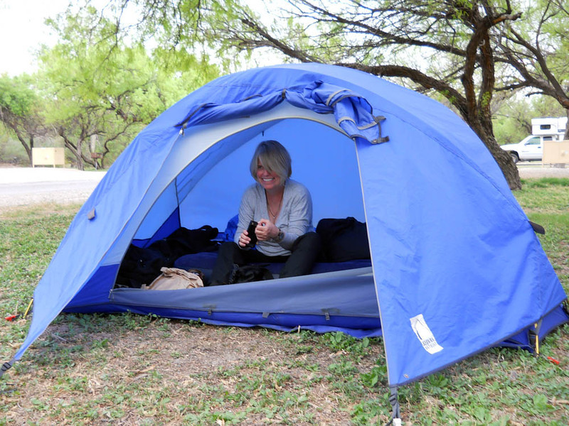 THE HAPPY CAMPER Mev in her beloved Sierra Designs Meteor Light CD tent. It's essentially like mine, only the pole arrangement was computer-designed (hence the CD) to relieve the stress of the two corner poles. They're great tents, CD or no CD.