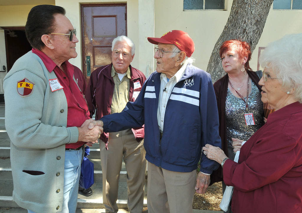 . Torrance---3/31/11---Daily Breeze Photo:  Robert Casillas ---  Torrance legend Louis Zamperini paid a visit to his alma mater Torrance High to visit with alumni and meet students. Zamperini visits with Torrance alum Ed Palmer.